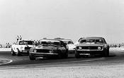 71015  -  First Lap   -  Moffat leads Jane s Camaro, Beechey s Monaro, McKeown s Porscheand Geoghegan  s Mustangs - Calder  1971