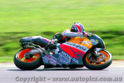 98302  -  Mick Doohan  -  Winning his 5th World Championship at Phillip Island - October 1998 - Photographer David Blanch
