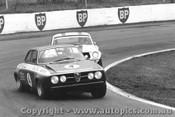 71031 - Foley s Alfa Romeo GTAM  leads Geoghegan s Mustang Oran Park 1971