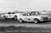 77004 - G. Rogers  Ford Escort - D. Seidel Mustang - Calder 1977