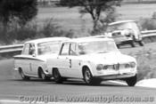 66010 - K Bartlett Alfa Romeo Giulia TI M. Volkers Lotus Cortina  - Warwick Farm 1966 - Photographer Lance Ruting