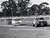 66211 - Bryan Thomson's Mustang ahead of Spencer Martin in Bob Jane's Lotus Cortina at Warwick Farm in 1966. - Photographer Lance J Ruting