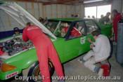 83721 - Rebuilding the XE Falcon after a crash in practice - Johnson / Bartlett -  Bathurst 1983