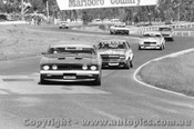 74034 - Allan Moffat Brut 33 XB Falcon Leading B. Sampson and P. Brock Torana SLR 5000 -  Sandown 1974