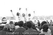 74039 - Allan Moffat Brut 33 XB Falcon - Winner of the Sandown 250 Celebrates with the Pitt Crew -  Sandown 1974