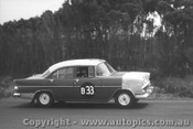 61712 - I. Strachan / J. Lanyon / D. Catzin  Holden EK - Armstrong 500 Phillip Island 1961