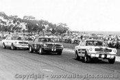 65032 - Pete  Geoghegan Norm Beechey and Bob Jane - The first time the three Mustangs raced together.  Calder  29/8/1965