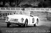 65426 - Unknown driver in a MGA at Gnoo Blas Orange 1965