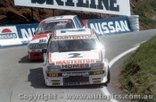 83741 - Masterton / Stewart  Ford Falcon XE / Brock / Perkins Commodore Bathurst 1983