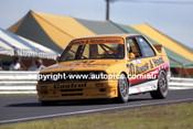91032 - Alan Jones, BMW - Lakeside  1991 - Photographer Marshall Cass