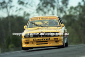 91033 - Alan Jones, BMW - Lakeside  1991 - Photographer Marshall Cass