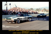 85725-1 - John Goss / Armin Hahne & Tim Wilkinshaw / Win Percy - Jaguar XJ-S - Bathurst 1985 - Printed with a black border and a caption discribing the photo.