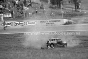 74428 - Russell Mills, Rolls his Morris Mini and is thrown from the car & trapped underneath. His seat belt snaped. Oran Park 3rd February 1974 - Photographer Lance J Ruting