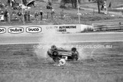 74427 - Russell Mills, Rolls his Morris Mini and is thrown from the car & trapped underneath. His seat belt snaped. Oran Park 3rd February 1974 - Photographer Lance J Ruting