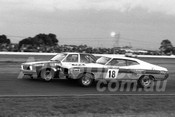 75105 - Murray Carter, Falcon & Rod McRae Torana SLR 5000 - Twilight meeting Calder 18th January 1975 - Photographer Peter D'Abbs