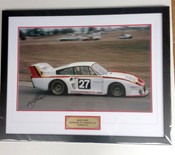 1170 - A personally singed  framed photo of Alan Jones Porsche 935