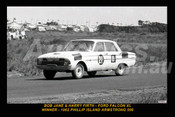 62750-1 - Harry Firth and Bob Jane - Ford Falcon XL - Winner of the Armstrong 500 - Phillip Island 1962 - Photographer Peter D'Abbs  - Printed with a black border and a caption discribing the photo.