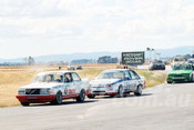 86098 - Robbie Francevlc, Volvo 240T / Peter Brock, Commodore -  Symmons Plains 8th March 1986 - Photographer Keith Midgley