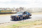 86100a - Jim Richards, BMW -  Symmons Plains 8th March 1986 - Photographer Keith Midgley