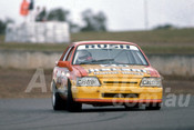 87103 - Garry Rush,  VK Commodore -  Oran Park 1987 - Photographer Ray Simpson