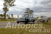 63048 - Harry Firth, Cortina & Laurie Stewart Morris 850  - Warwick Farm 1963 - Photographer Peter Wilson