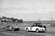 62409 - R. Tresise MGA 1600 / Allan Moffat Triumph TR3A / T. Schenken GTA 30 - Calder 24th February 1963