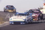82127 - Allan Moffat & Barry Jones, Mazdz RX7 - Amaroo Park 1982  - Photographer  Lance J Ruting