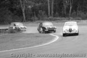 64025 - B. Jane Jaguar- P. Geoghegan Lotus Cortina - P. Manton Morris Cooper S -  Warwick Farm 1964 - Photographer Lance Ruting