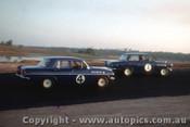 64042 - Norm Beechey Holden  EH S4  / Jim McKeown Lotus Cortina -  Lakeside  1964 - Photographer John Stanley