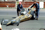 66904 - George  The Bushmaster  Schrieber  AA/Fuel Dragster  Yellow Fang  - Surfers Paradise 1966 - Photographer John Stanley