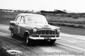 61003 - T. Niovanni Holden FE  -  Phillip Island - 13th April 1961 - Photographer Peter D Abbs
