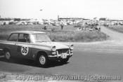 60733 - G. Hoinville / A. Miller Triumph Herald  - Armstrong 500 Phillip Island 1960