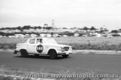 61721 - G. Martyr / F. Sutherland / B. Graetz   Studebaker Lark - Armstrong 500 Phillip Island 1961