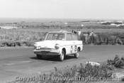 62744 - K. Burns / G. Hoinville / G. Hughes  Ford Anglia  - Armstrong 500 - Phillip Island 1962