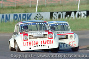 84031 - S. Evans / R. Taylor  Morris Mini s - Oran Park 17th November 1984