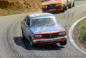77785  - L. Brown / B. Stewart  Mazda RX3  22 Outright - Bathurst 1977 - Photographer Lance J Ruting