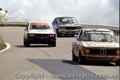 77800  - P. Ward / P. Lucas  BMW 2002 Tii  106 laps completed & Y. Katayama / G. Leeds  Mazda RX3 -  Bathurst 1977- Photographer  Richard Austin
