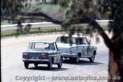 64734 - J. Bonthorne / J. Dano Cortina 1500 - L. Park / J. Roxburgh Renault R8 - Bathurst 1964 - Photographer Richard Austin