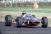 68576 - Piers  Courage  - McLaren M4A -   Warwick Farm Tasman Series 1968 - Photographer Richard Austin