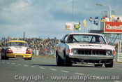 74097 - John  McCormack Ansett Charger / Jim McKeown  Porsche - Oran Park 4th August 1974 -  - Photographer Jeff Nield