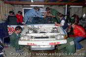 83767- Rebuilding the XE Commodore after a crash in practice - Harris / Cooke -  Bathurst 1983 - Photographer Lance J Ruting