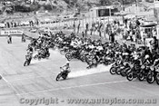 70302 - The Start of the Castrol Six Hour - 68 Bike Le Mans Start - P. Jones/ G. Laing on a Suzuki T350-2 got the best of the start - Amaroo 18th October 1970 - Photographer Lance J Ruting