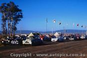 59010 - J. French and Leo Geoghegan FX Holden and B. Pitt Jaguar - Bathurst 1959 - Photographer  Harry Cape