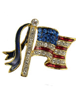 "Beautiful American flag brooch/pin with red enamel stripes and diamond like crystal stripes and pole. Blue Swarovski crystal depict the stars. Goldplate. Size 1.25""H x 1""W."