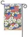 "American Daisies Patriotic Garden Flag features colorful white daisies and USA flags displayed in red, white and blue patriotic container by Artist Kathleen Parr McKenna. Printed Patriotic Summer Garden Flag Measures 12.5"" x 18""."