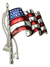 "The silver-plate Parade Flag pin with commemorative tassel and waving design, is a beautiful addition to your best Fourth of July ensemble. But don't save it for just once a year; wear this pin with pride anytime to honor those who have helped to preserve our freedom. Red and Blue enamel with Silverplate. 2"" tall pin."