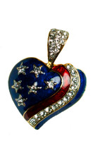 "Gold-plate, enamel with Swarovski crystal stars and ribbon in the shape of a heart. Size: 1.25""H x 1.75""W."