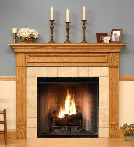 The Forestdale custom fireplace is show in one of the six wood type options available.
