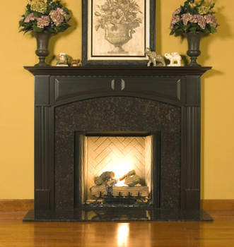 The elegant Lennox Custom Fireplace mantel is shown here with a granite facing kit.