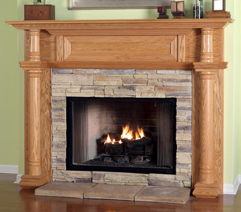 the chapman fireplace mantel has a wood framed top panel
